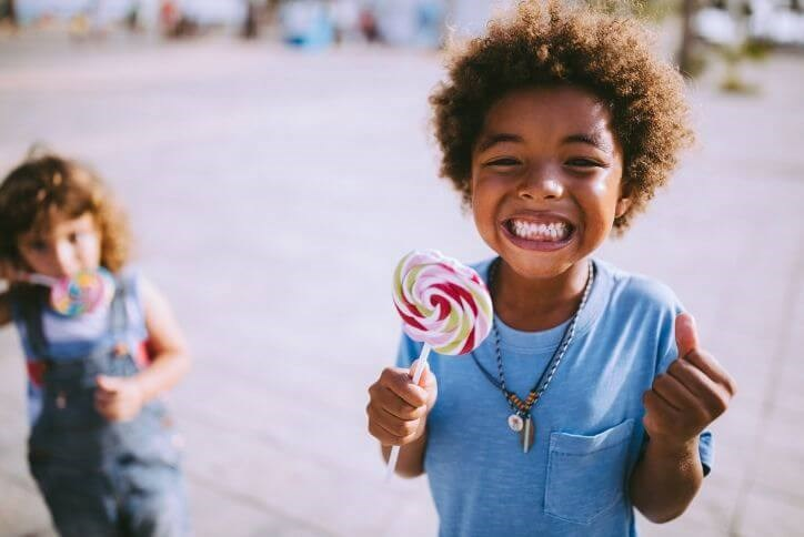 Excited boy with lollipop | Hollyhock, a new home community in Frisco, TX